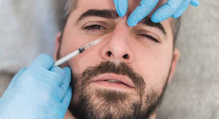 Man rceiving botox to the forehead at botox clinic